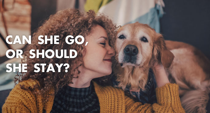 A woman with her dog wonders whether she will bring her pet for an overseas move or not