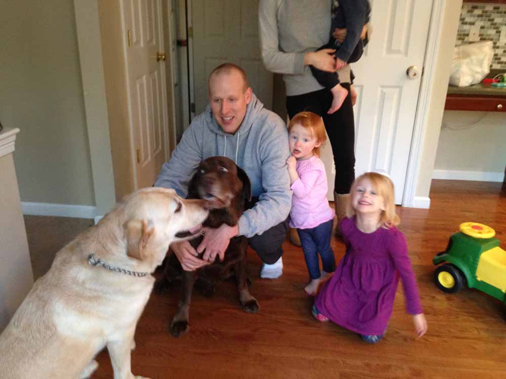two-labs-and-family-with-three-kids-and-parents